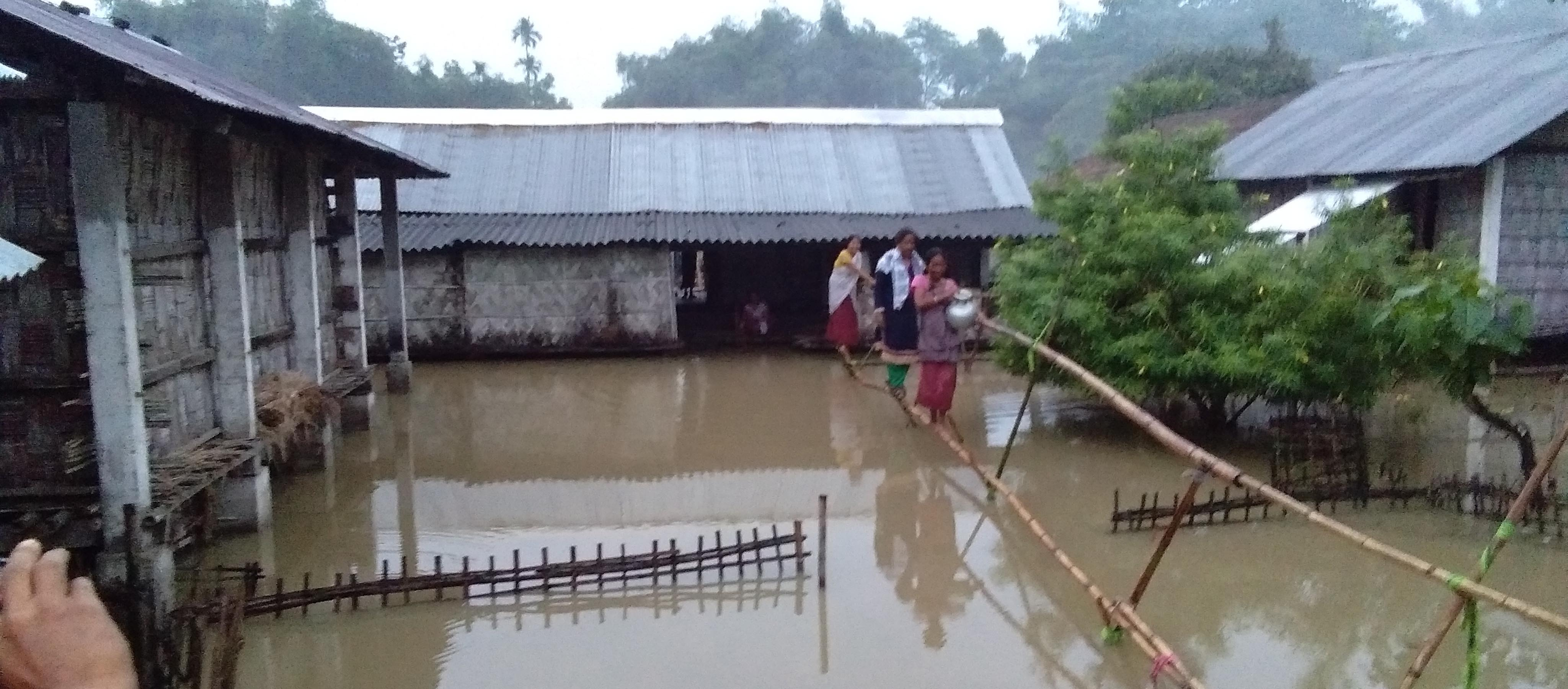 Houses submerged under flood due to heavy shower in the last few days at Tinsukia on Saturday. Photo by UB Photos.