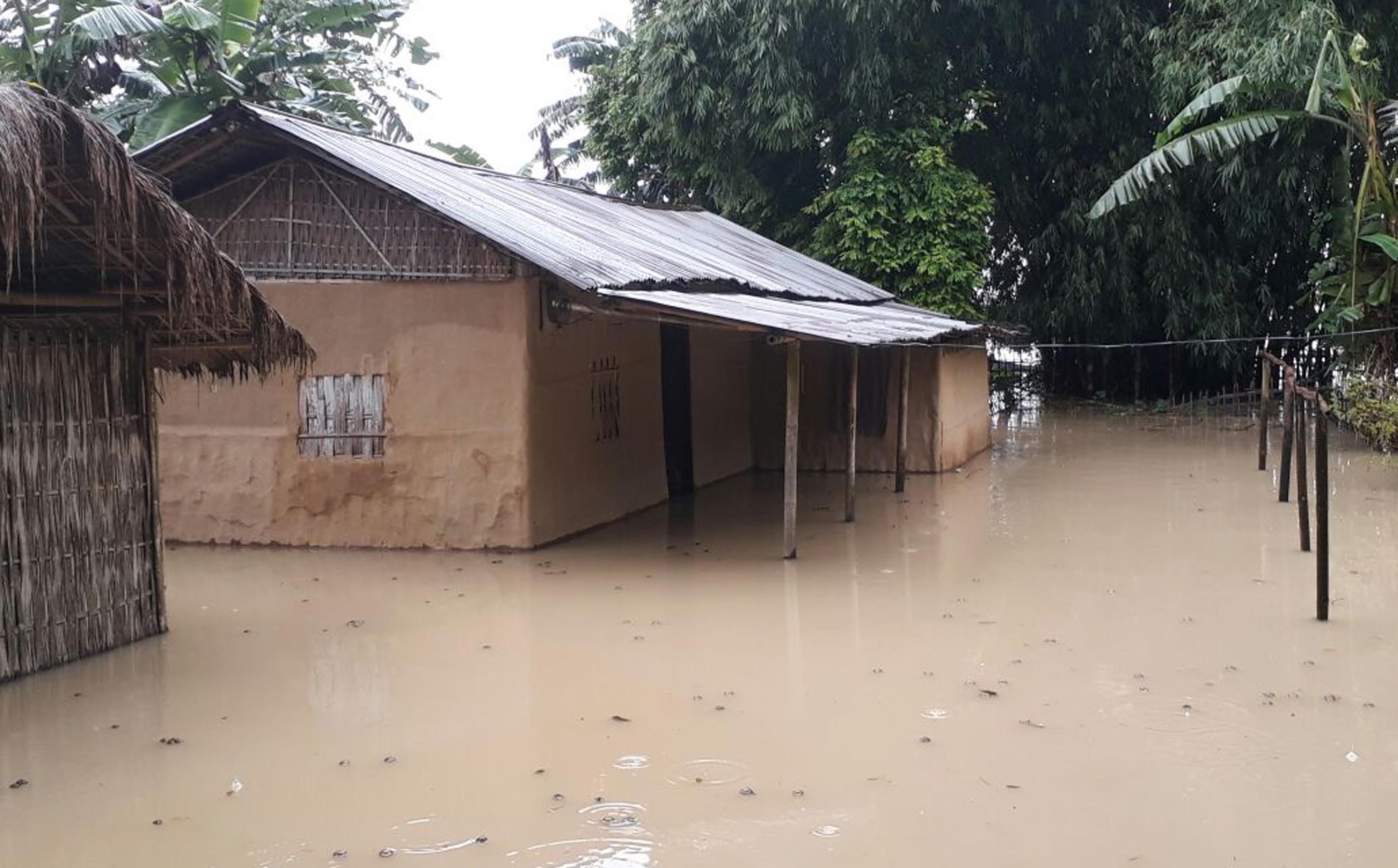 Houses submerged under flood due to heavy shower in the last few days at Tinsukia on Saturday. / UB Photos