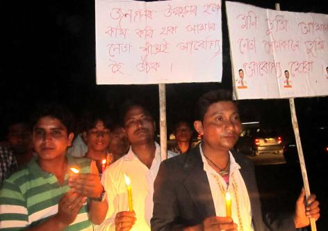 Candle light prayer at Narayanpur for quick recovery of Mani Kumar Subba