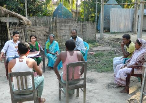 Don Bosco University students interact with villagers on mental health.