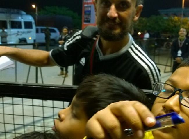 FC Pune City's midfielder Tuncay Sanli with fans at Guwahati on Tuesday