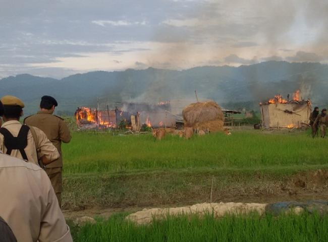 The burnung hemlet: thatched houses set on fire by miscreants in Uriam Ghat area. Photo: Bibeka Dutta