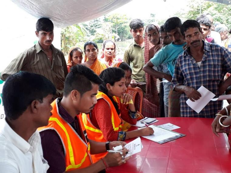 NEADS volunteers are distributing relief aid to the affected people of Karimganj
