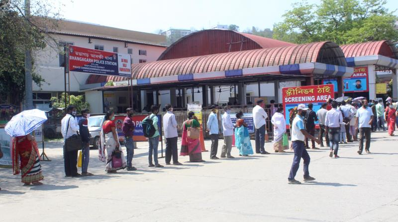 People queue for screening at GMCH in Guwahati on 08-05-20. Pix BY UB photos