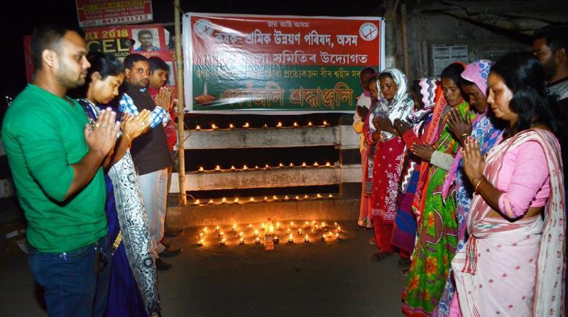 Tribute paid to CRPF jawans killed in Kashmir by terrists atatck by Kishak sramil unyan parishad at Nagaon on Friday. Photo: UB Photos