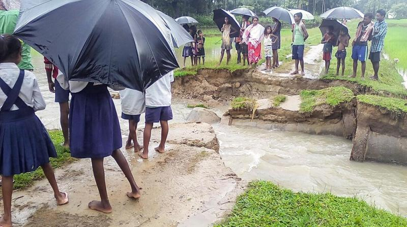Flood water washed away portion of a road at Mijika in Biswanath Chariali on Friday. Photo by UB Photos.