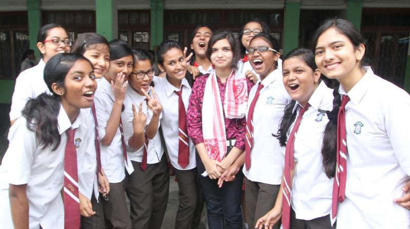 HS Arts 3rd position holder of Mousana Nitingle Chowdhury of St. Mary's School celebrating her victory with friends