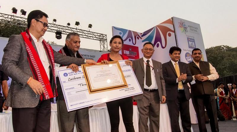 L Sarita Devi is being felicitated