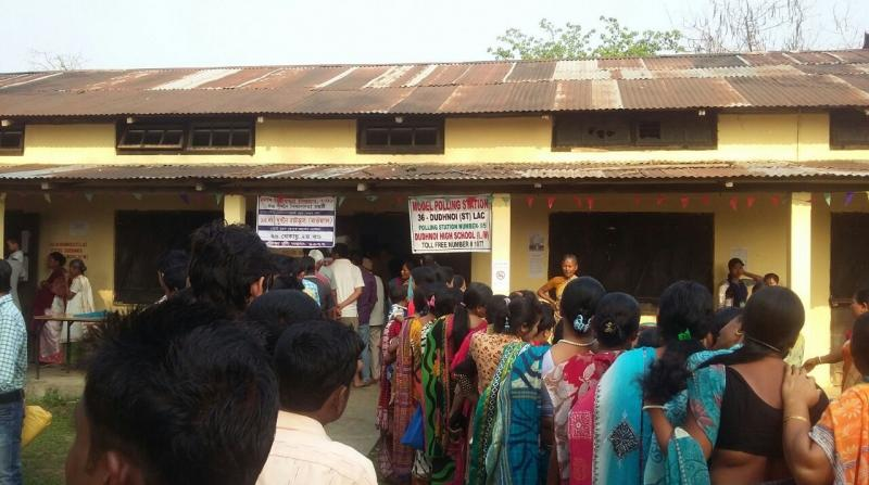 Voters lined up in fromt of a model polling station at Dudhnoi HIgh School