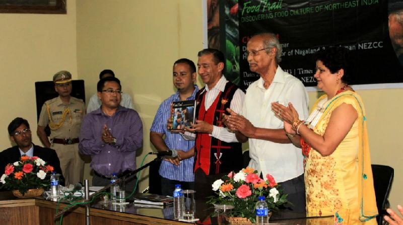 Nagaland Governor Ashwani Kumar releasing the book. Flanked by Som Kamei (L), Aiyushman Dutta (2L) and Prof AC Bhagawati (R)