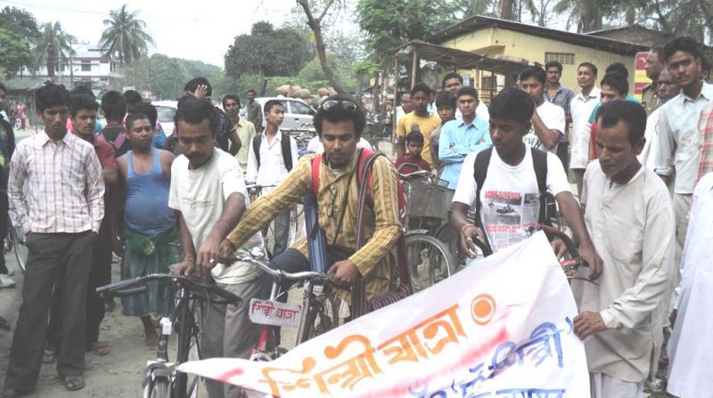 Mrinal Dev Sarmah and Jinku bicycle tour