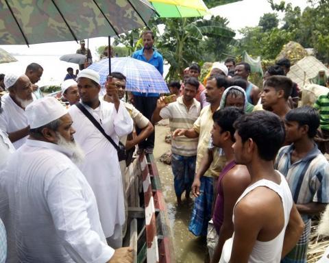 AIUDF Chief Badruddin Ajmal meeting flood affected  villagers at Bilashipara in Dhubri on Wednesday. Photo by UB Photos.