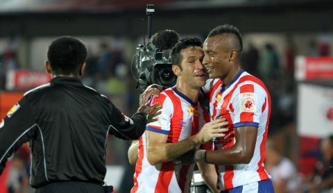 Fikru Tefera Lemessa of Atletico de Kolkata celebrates his goal with Luis Javier Garcia Sanz of Atletico de Kolkata during match 5 of the Hero Indian Super League between NorthEast United FC and Atletico de Kolkata held at the Indira Gandhi Stadium, Guwahati, India on the 16th October 2014.  Photo by: Deepak Malik/ ISL/ SPORTZPICS