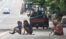 Beggars in the empty GS Road, near Bhangarh during Lockdown in the city on Sunday. Photo by UB photos