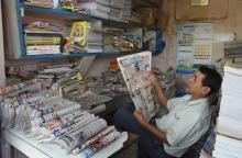 A newspaper salesman reads a local newspaper during Janata Curfew at Tezpur on 22-03-2020. Pix by UB Photos