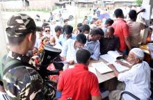 People queue up to check their names in final NRC list at Bhojkhowa in Tezpur on Saturday. Photo: UB Photos