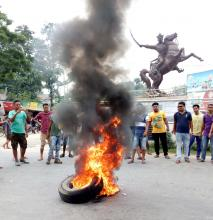 Protesters burning tyres on National Highway-31 during 48 hours Assam Bandh called by Assam Koch Rajbongshi Students' Union (AKRASU) at Uttar Salmara in Abhayapuri in onThursday. Photo by UB Photos