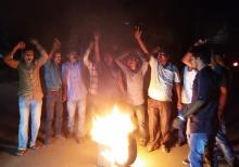 Activists of Krishak Mukti Sangram Samiti (KMSS) protest by burning tyres in front of DC Office against arresting the KMSS leader Akhil Gogoi in Golaghat on Tuesday. Photo by UB Photos.