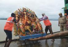 GMC worker carrying an idol of Goddess Durga for immersion in the Brahmaputra river on Bijoya Dashami at Kasomari Ghat in Guwahati on Saturday. Photo by UB Photos