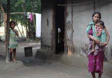 A Displaced Koch Rajbanshi woman with her children