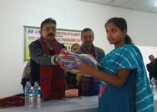 Madhav Prasad Sarma, Kokrajhar DC giving away blanket to a beneficiary at a programme in Kokrajhar, on Wednesday