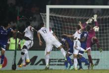Chennaiyin FC goalkeeper Gennaro Bracigliano fails to make the save as Massamba Lo Sambou of NorthEast (far Left) United FC scores the second goal during match 42 of the Hero Indian Super League between NorthEast United FC and Chennaiyin FC held at the Indira Gandhi Stadium, Guwahati, India on the 27th November 2014. Photo by: Shaun Roy/ ISL/ SPORTZPICS
