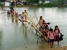 School children are facing hardship in communication to their school in Karimganj district because of flood