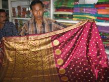 Salesman displaying a traditional Assamese saree at govt-run handloom stall 'Jagaran''. Photo: Subhrajyoti Baruah.