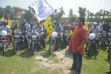 ABSU president Promod Boro while flagging off grand bike rally